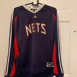 NJ nets shooting sleeve size large preowned